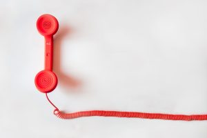 a red coloured telephone